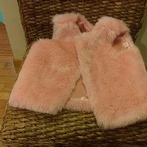 A pink plush vest
